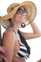 Smiling Woman Wearing Sunglasses and Floppy Hat on Beach, Portrait, Aruba