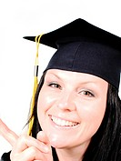smiling brunet student girl in cap over white