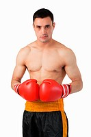 Young boxer with boxing gloves on against a white background