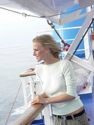 Young woman on cruise ship deck                                                                                                                       ...