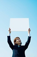 Businessman Holding Message Board Aloft