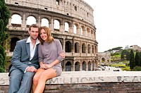 Couple in front of the Roman Colosseum