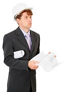 Serious engineer in helmet with documentation in hands