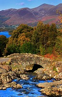 Ashness Bridge with the Skiddaw Range in the background, Lake District, Cumbria, England, Europe