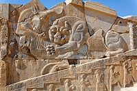 Bas relief carving of a lion hunting a bull, Persepolis, Iran