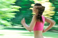 Young woman running outdoor _ motion blurr