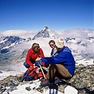 3 alpinists in front of the top of the Matterhorn, Zermatt, canton Valais, Switzerland