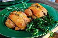 Roast chicken on rosemary