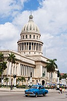classic America cars outside Capitolio Nacional, Capitol building, Central Havana, Cuba, West Indies, The Caribbean.