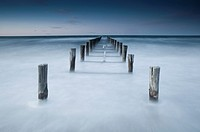Decayed wooden jetty, Beach of Zingst, Baltic Sea, Germany