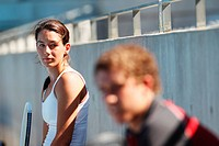 Young Male and Female Tennis Players Taking a Break