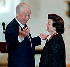 Boris Yeltsin with Valentina Tereshkova. Russian president Boris Yeltsin 1931_2007 decorating Valentina Tereshkova born 1937 with a state award. Teres...