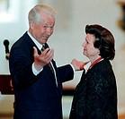 Boris Yeltsin with Valentina Tereshkova. Russian president Boris Yeltsin 1931_2007 decorating Valentina Tereshkova born 1937 with a state award. Teres...