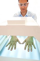 Phototherapy booth. Patient with their hands in a phototherapy box