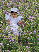 Small girl at green heaths, Plateau of flowers, Kaas, Satara, Maharashtra, India