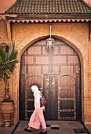 Moroccan girl walking, Marrakech, Morocco