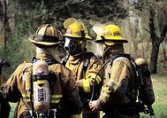 Firefighters discussing strategy at a house fire