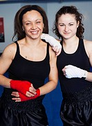 Two women getting ready for kickboxing
