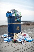 Overflowing rubbish bins on Aberystwyth promenade at the end of a hot september afternoon, Wales UK