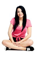 Happy and calm young woman sitting cross legged