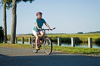 Seventy one year old, senior female riding a bicycle