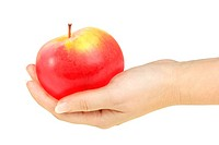 Single red apple in a hand of woman