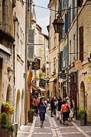 Shoppers and tourists in the narrow old shopping streets of Perigueux, Dordogne, France