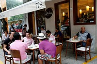 People sitting at Dulca cafe in the fashionable Rua Oscar Freire street in the Jardins area, Sao Paulo, Brazil