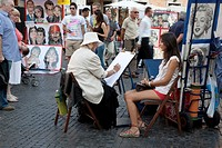 Young Woman and Portrait Artist in the Piazza Navona Square, Rome, Italy, Europe