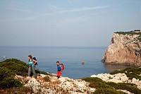 People hiking on the the Capo Caccia, Alghero, Sardinia, Italy