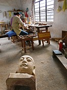 Worker sculpting and wood carving at his studio. Suzhou. China