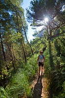Woman hiking in forest, Alcudia, Majorca, Spain