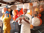 Chef holding salmon on boat