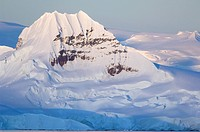 Antarctic Peninsula, Bransfield Strait. Mountain peak at sunrise.