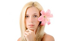 Beautiful blond woman with pink lily isolated on white