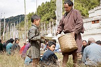 Bhutan, Himalaya, lunch for praying people in the countryside in front of a temple.
