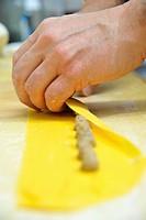 Chef rolling homemade agnolotti pasta