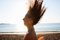Woman playing with her hair on beach