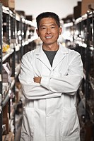 Asian man working in electronics factory