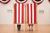 Voters voting in polling place (thumbnail)