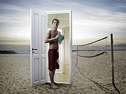 Man emerging from door on beach