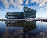 Harpa Concert Hall and Conference Center, Reykjavik Iceland  Situated on the boundary between land and sea, the building is a gleaming sculpture refle...