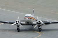Old airplane Douglas DC-3 Dakota running on the taxiway, Anchorage, Alaska, USA
