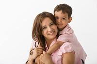 Hispanic son hugging mother