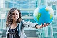 Caucasian businesswoman holding globe