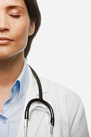 Hispanic doctor with eyes closed
