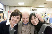 New ´best friends´: overseas visitor with two helpful tourist information professionals in Hiroshima, Japan. MR