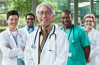 Smiling doctors standing together