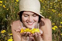 Caucasian woman picking wildflowers in field