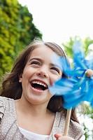 Grinning girl holding pinwheel